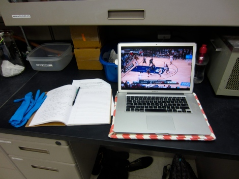 Necessary lab equipment: gloves, lab notebook, top-sealed water bottle, laptop, and college basketball conference championships streaming live on ESPN.com.