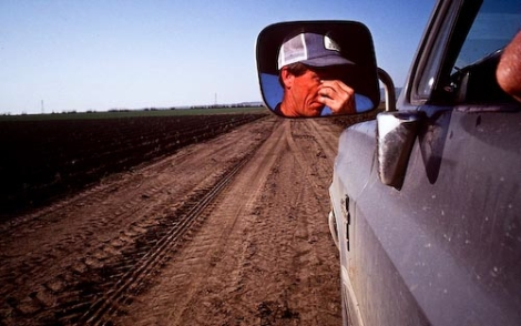 A farmer wipes his eyes after driving through dry fields in near the town of Huron in California's San Joaquin Valley. Photo by Scott Anger via Creative Commons, all rights reserved.